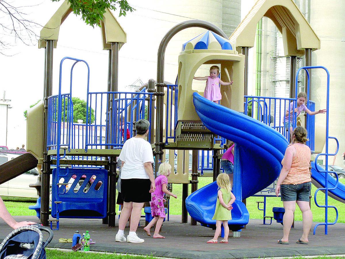 kids playing on the new playground equipment